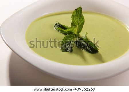 Green soup with Mint in plate - stock photo