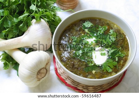 Green soup with sour cream - stock photo