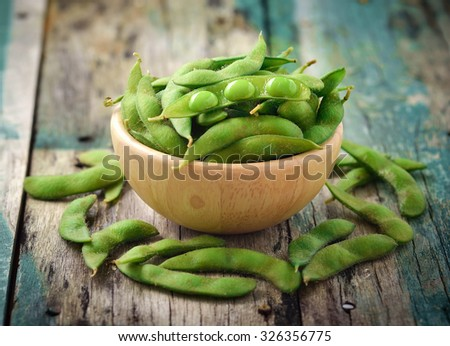 green soy beans in the wood bowl on table - stock photo