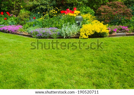 green space with flowers in the background - stock photo