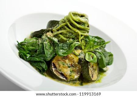 Green Spaghetti with Zucchini, Fresh Spinach and Pesto Sauce - stock photo