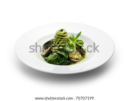 Green Spaghetti with Zuchinni, Fresh Spinach and Pesto Sauce - stock photo