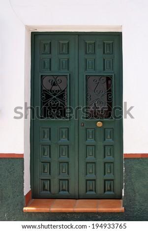 green spanish wooden door - stock photo