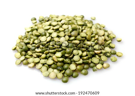 Green split peas on white background - stock photo