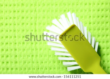 Green sponge background and cleaning brush - stock photo