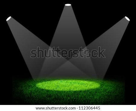 Green sport field under spotlight background - stock photo