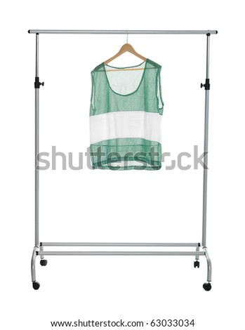 Green sport shirt on a Clothes Rack isolated - stock photo