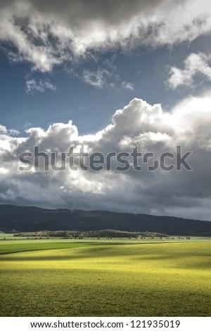 Green spring farm fields under a big sky in Oregon - stock photo