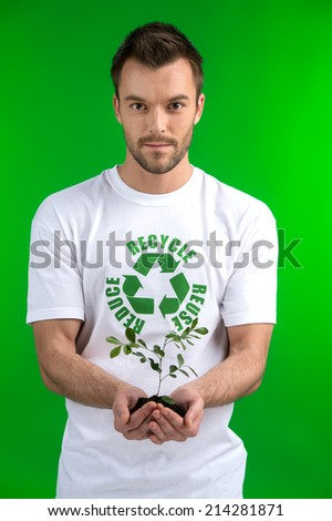 green sprout in business man hand. Business man holding small plant  - stock photo