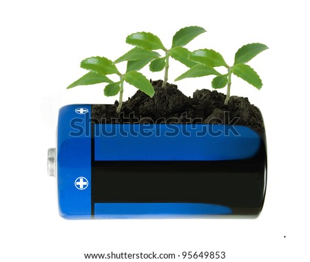 Green sprouts like wind turbines growing up from soil in electric battery. Concept of alternative source of energy - stock photo