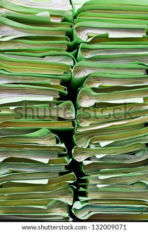 green stacks of office folders with documents - stock photo