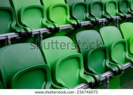 Green stadium seats - stock photo