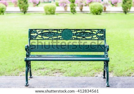 Green Stainless Steel bench on park garden background - stock photo