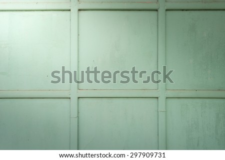 green steel wall background with light from corner - stock photo
