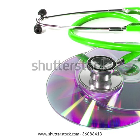 Green Stethoscope and a cd disk - checking the content of the disk. Could be used for medical and computer purposes! Highkey image!