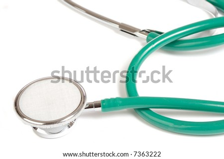 Green stethoscope isolated over white background - stock photo