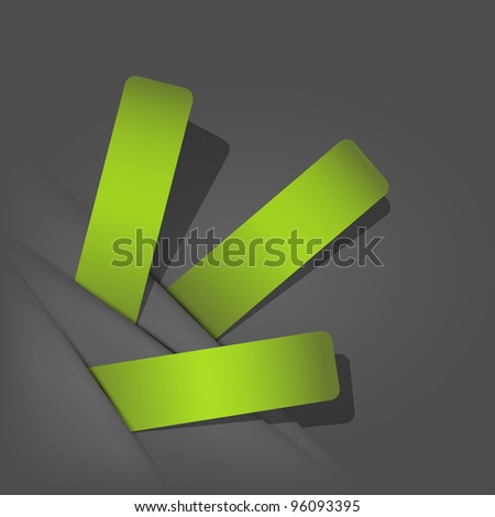 Green stickers sticking out of the divider on paper background. - stock photo