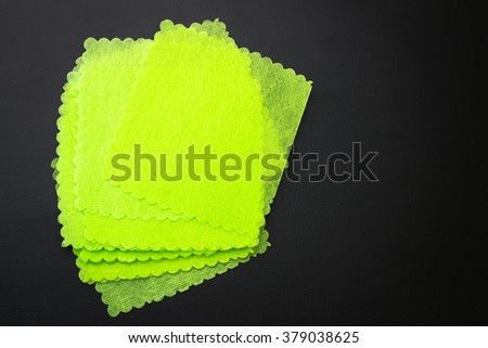 green sticky note isolated on white background.