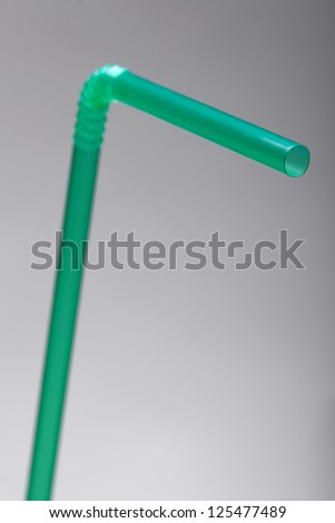 green straw on grey background with a shallow depth of field - stock photo
