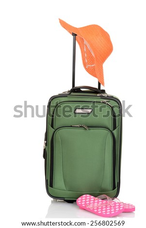 green suitcase with hat and sandals - stock photo
