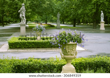 green summer park in Warsaw city with focus on flower pot