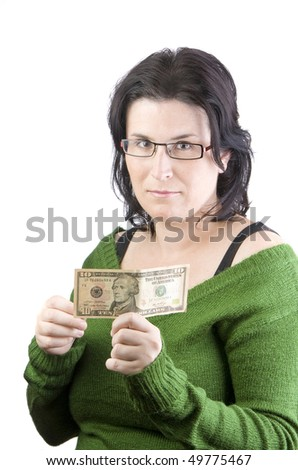 green sweater woman holding dollar banknotes thinking in spending or investing money