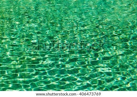 Green swimming pool rippled water detail