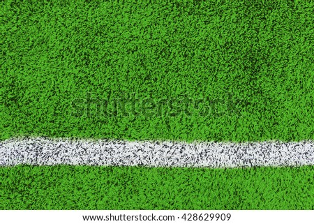 green synthetic grass sports field with white line background - stock photo