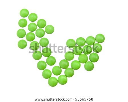 green tablets in arrow formation, isolated on white background - stock photo
