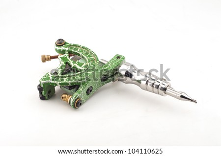 Green tattoo machine on a white background