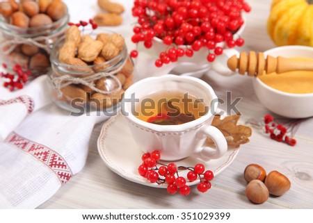 green tea and viburnum berry - stock photo