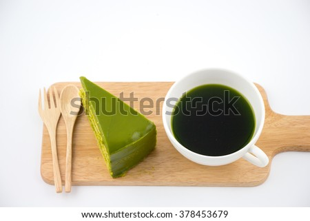 Green tea cake and green tea cup set on wooden plate  - stock photo