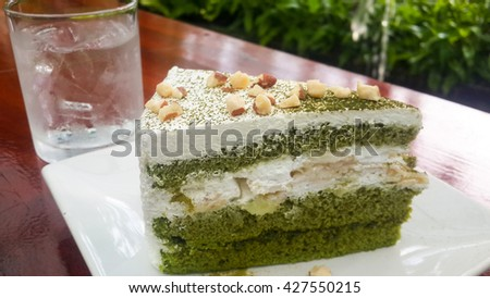Green tea cake, Matcha Green tea cake on blurred background. - stock photo