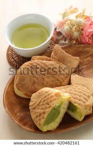 green tea cream filling Taiyaki, Japanese fast food with tea - stock photo