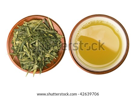 green tea cup with leafs, top view - stock photo