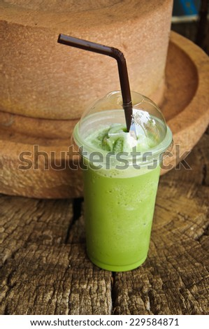 Green Tea Frappe on wood table - stock photo