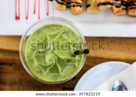 Green tea Frappe with wafer pie chocolate and strawberry jam. Very chill time in afternoon. Green tea Frappe. Chill time - stock photo