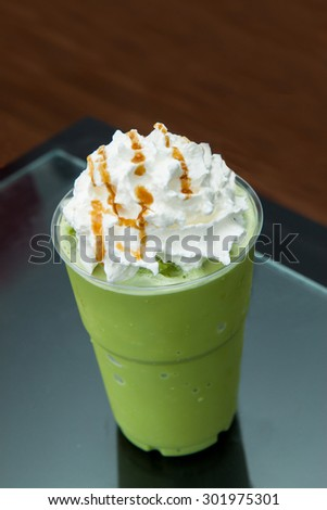 Green tea frappe with whipped cream on plastic cup. - stock photo