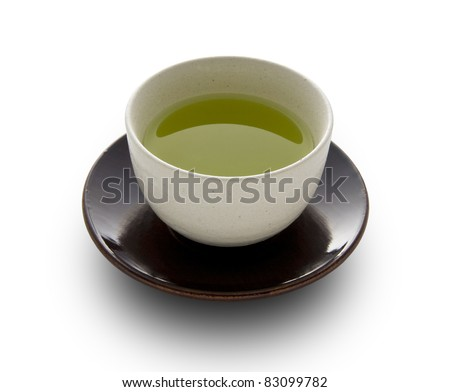 Green tea in a white cup on a white background - stock photo