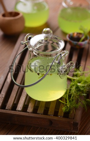 Green tea in glass teapot
