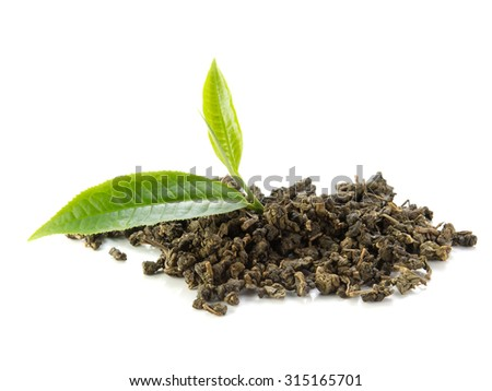 Green tea leaves and dry tea on white background. - stock photo