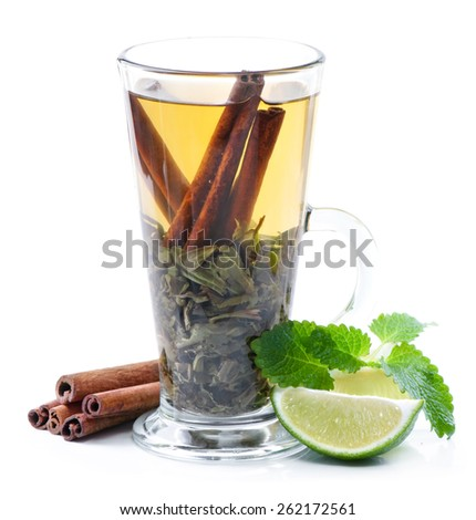Green tea, lime and  cinnamon. - stock photo