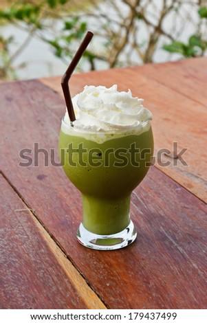 green tea on the wood garden table - stock photo