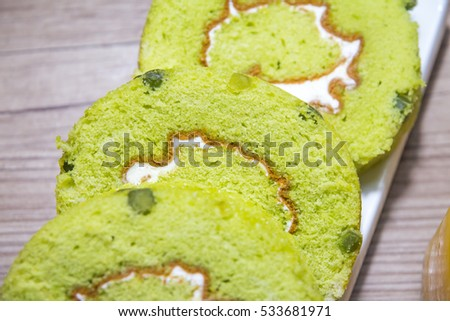 Green tea roll cake and orange juice