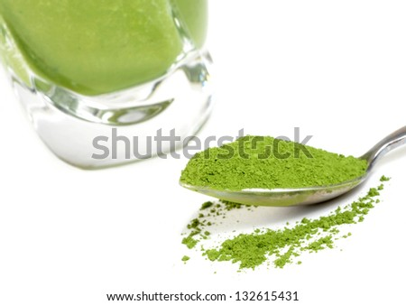 Green tea smoothie and matcha. Focus is on the matcha - stock photo