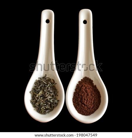 Green tea versus coffee on a black background - stock photo