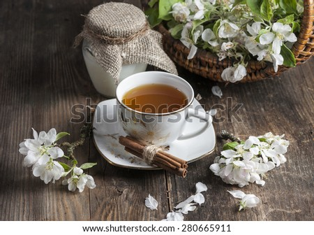Green tea with apple blossom on old wooden table - stock photo