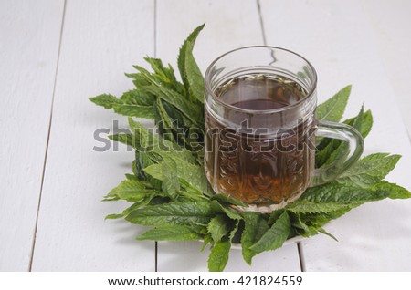 green tea with herbs and spices on a white background