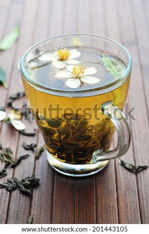 Green tea with jasmine flowers  - stock photo