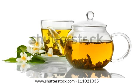 green tea with jasmine in cup and teapot isolated on white - stock photo